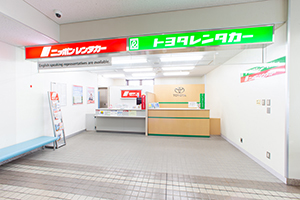 2-1. On the left side, there are NIPPON Rent a Car and TOYOTA Rent a Car counters.