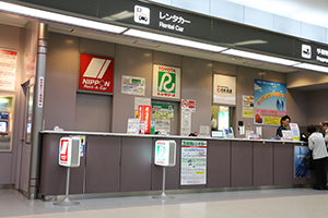 9. In front of the Counter, there are NIPPON Rent-A-Car and TOYOTA Rent a Car reception desks.